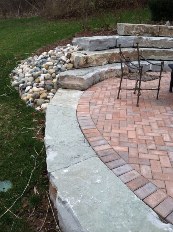 stone ampitheathre retaining wall and brick paver patio 1