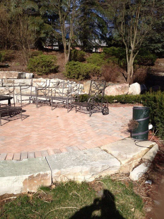 stone ampitheathre retaining wall and brick paver patio