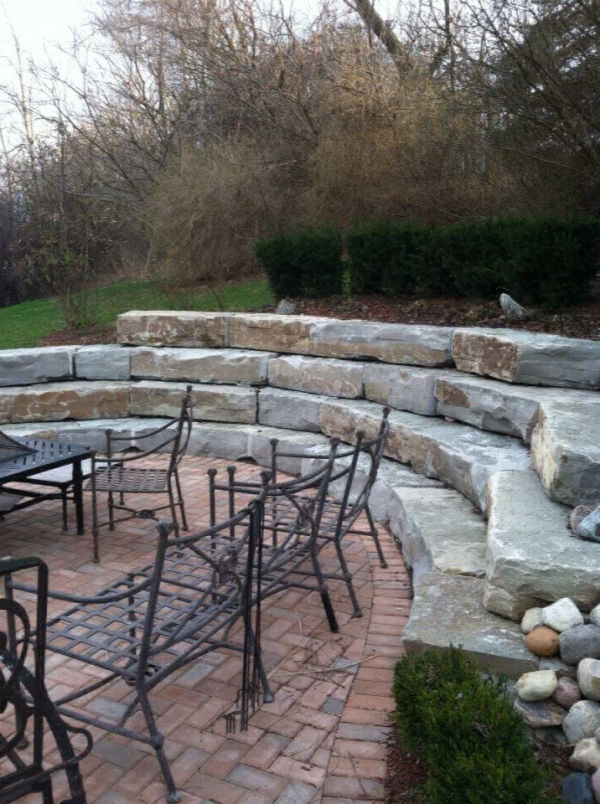 stone ampitheathre retaining wall and brick paver patio 3