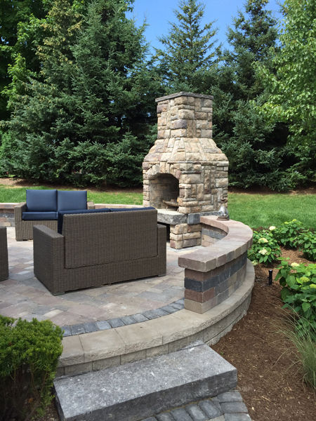 stone paver outdoor fireplace and stone paver patio