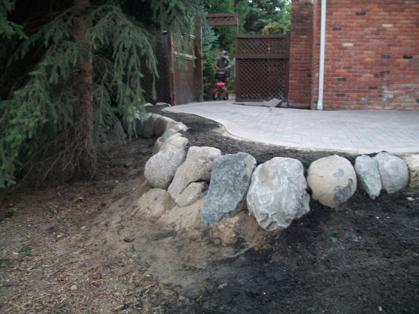 Brick Paver Patio and Stone Retaining Wall