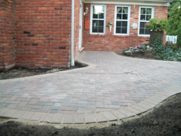 Brick Paver Patio and Stone Retaining Wall Side View