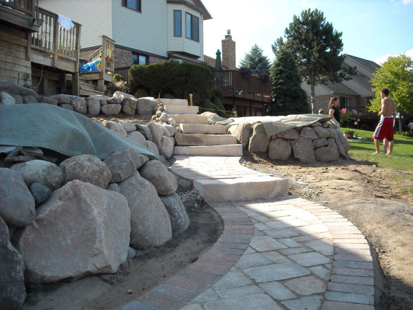 Stone Retaining Wall and Brick Paver Walkway