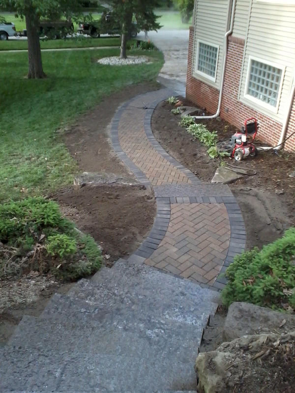 stone slab steps  and brick paver walkway